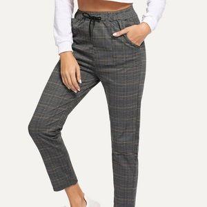 Grey plaid drawstring waist pants.
